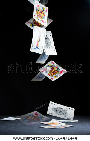 Playing cards falling - stock photo