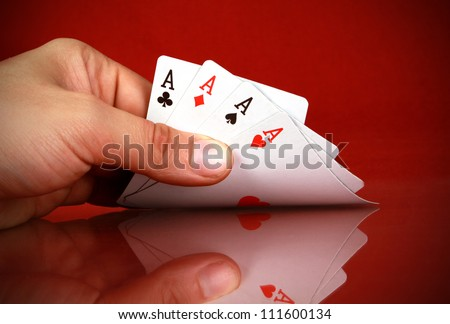 playing cards (four of a kind) in the hand - stock photo