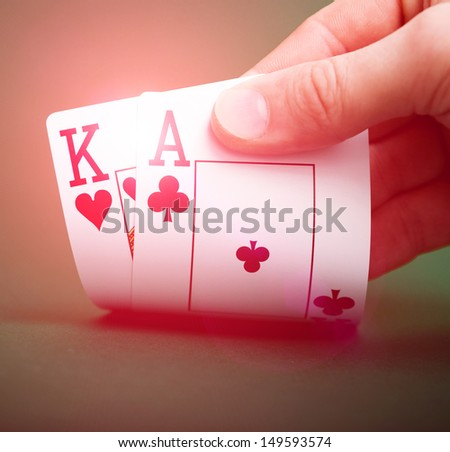 playing cards in hand on a green table casino - stock photo