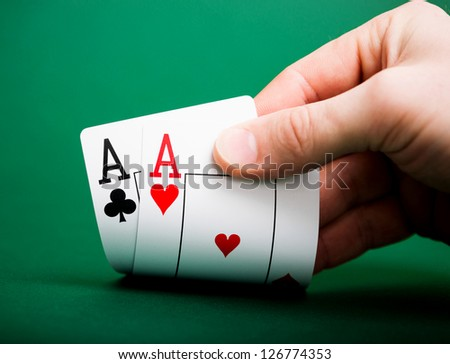 playing cards on a green table casino