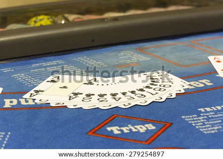 Playing cards on blackjack table