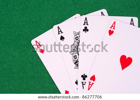 playing cards on green background - stock photo
