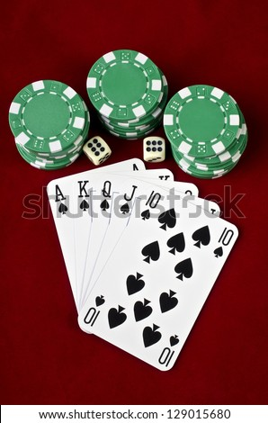 Playing cards (Royal flush) closeup, casino chips and dices