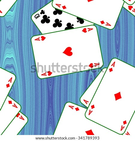 Playing cards scattered on a blue table. Seamless pattern texture background. The table in the gaming casino.