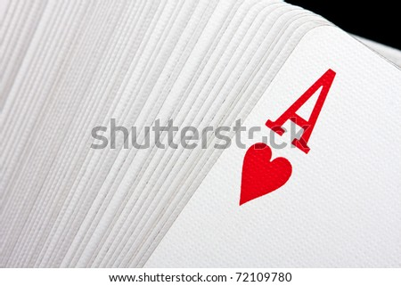 Playing cards with ace of hearts on top - stock photo