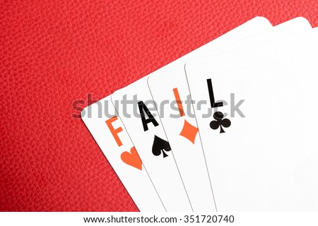 "Playing cards with ""FAIL"" text - stock photo"