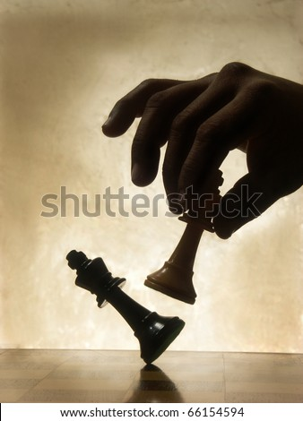 Playing chess game. defeating the Queen. - stock photo