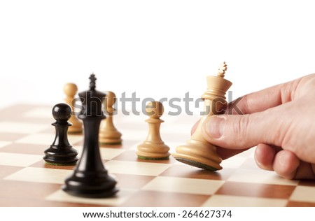 Playing chess - hand moving white king - stock photo