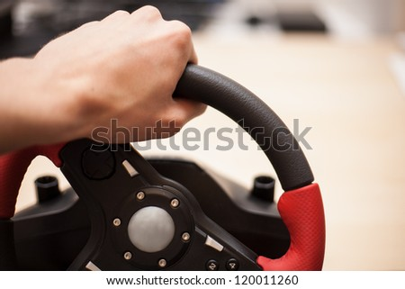 Playing computer games with computer wheele - stock photo