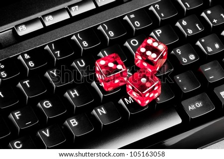 playing dice for game online on computer keyboard - stock photo