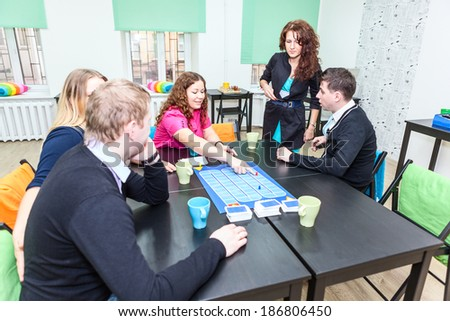 Playing exciting guessing game at party - stock photo