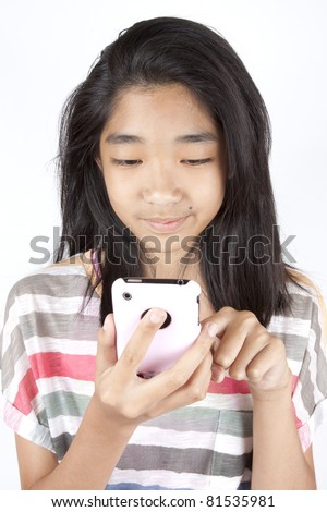 playing games, Asian teen girl playing game on smart phone.