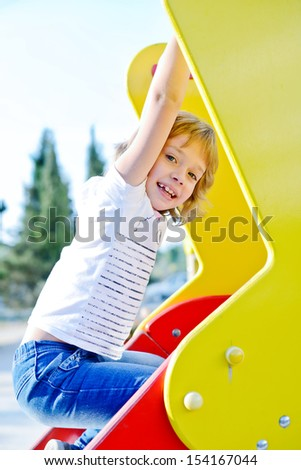playing� girl  on the playground - stock photo