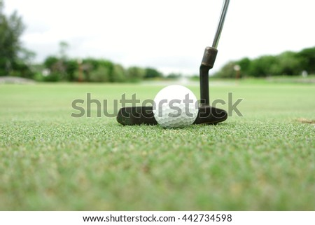 Playing golf. Golf club and ball  - stock photo
