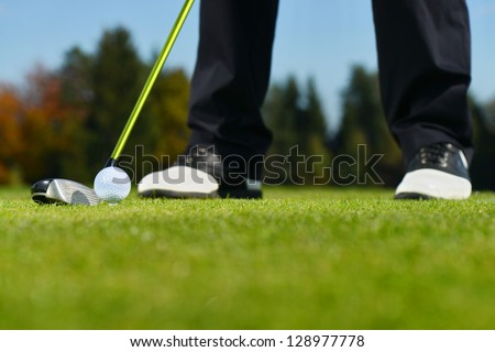 Playing golf. Golf club and ball. Preparing to shot - stock photo