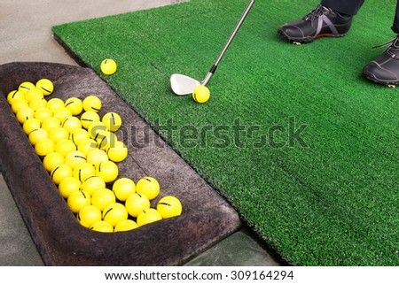 playing golf on a golf course in cloudy weather - stock photo