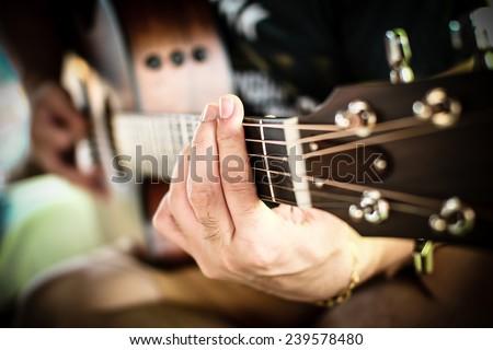 Playing guitar close up. selective focus image - stock photo