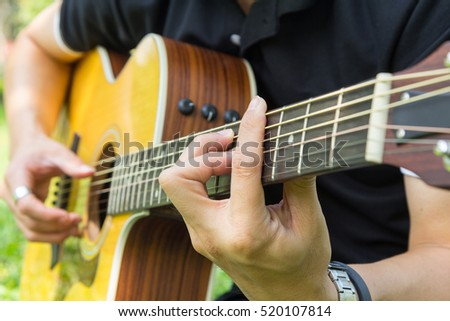 playing guitar in the park / chord Ab