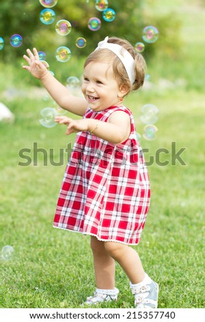 Playing in the garden baby girl  - stock photo