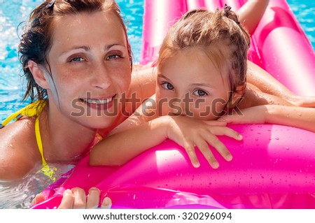playing in the swimming-pool with mom - stock photo
