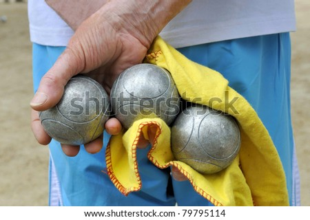Playing jeu de boules in France, Europe - stock photo