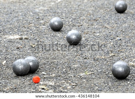 Playing jeu de boules or also called petanque in France. This play is played at street in every village of France. - stock photo