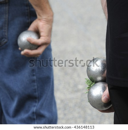 Playing jeu de boules or also called petanque in France. This play is played at street in every village of France. Selective focus at right balls.