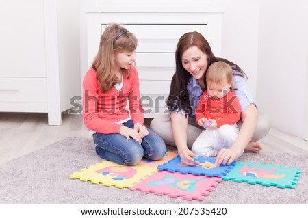 playing learning teaching family mother - stock photo