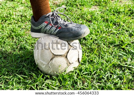 Playing old football on grass field