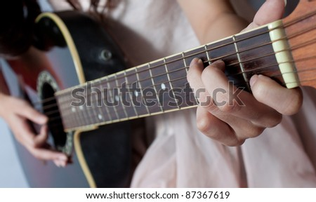 Playing on C major chord, shallow depth of field - stock photo