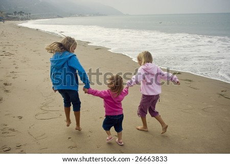 Playing on the Beach - stock photo