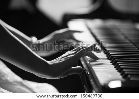 Playing piano - stock photo