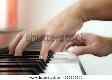 Playing piano and hand. - stock photo