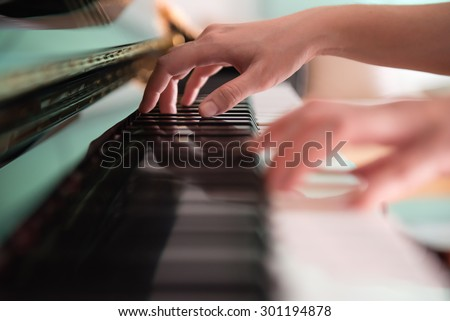 playing piano (soft focus) - stock photo
