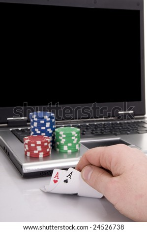 playing poker at home with the online game - stock photo