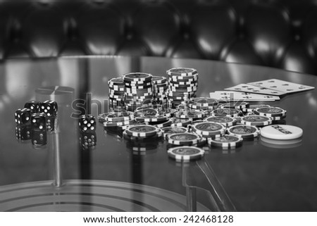 Playing poker chips on a glass table. Playing cards on a gambling table. Gambling, dice, poker. - stock photo
