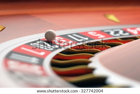 Playing roulette in the casino. Depth of field with focus on the ball. - stock photo