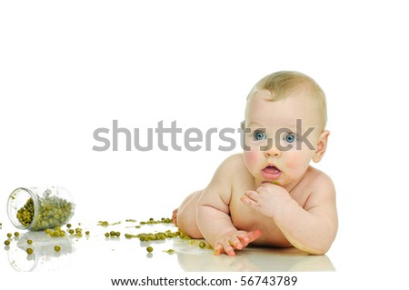 playing six month baby with jar of pea  on white