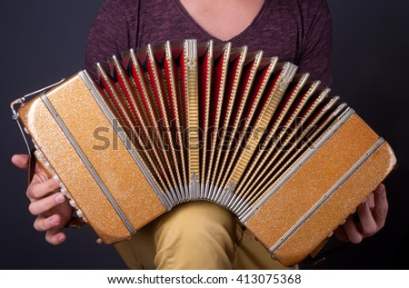Playing the bandoneon, traditional tango instrument, Argentina. - stock photo