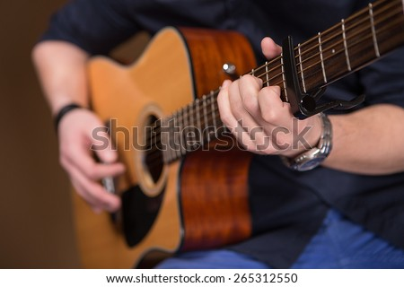 playing the guitar. close.