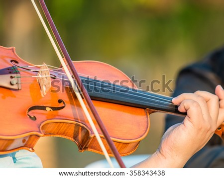 Playing violin music - stock photo