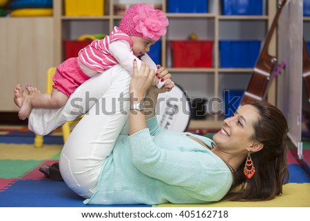 Playing with Mom in the playroom