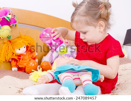 Playing with the doll girl