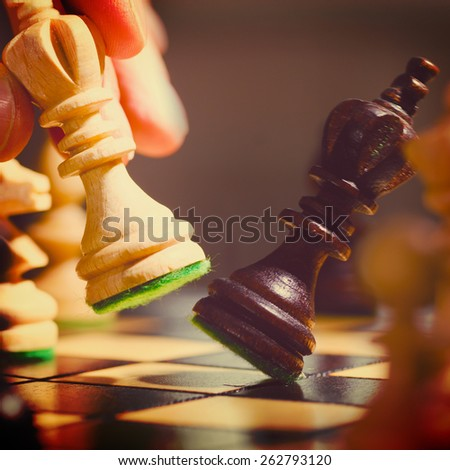 playing wooden chess pieces , warm colors toned - stock photo