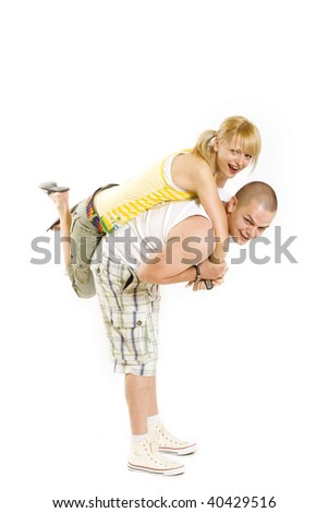 playing young couple isolated on white, woman on the back of her boyfriend