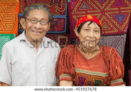 PLAYON CHICO, GUNA YALA/PANAMA - APRIL 17: unidentified handsome Guna Yala couple (husband and wife) on April 17, 2013 in Playon Chico. The Guna Yala are an indigenous people of Panama and Colombia.  - stock photo
