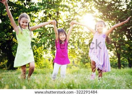 Playtime Arms Raised Cheerful Happiness Girls Concept - stock photo