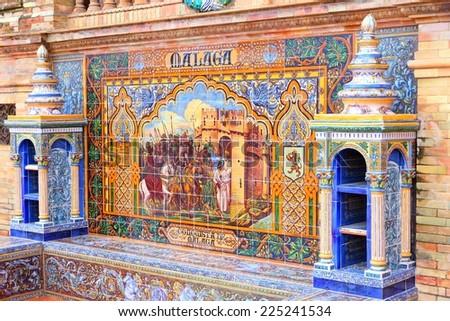 Plaza de Espana, Sevilla, Spain - famous old decorative ceramics alcove. Malaga theme. - stock photo