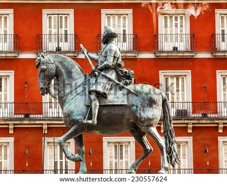 Plaza Mayor Built in the 1617 Famous Square Cityscape Madrid Spain. King Philip III Equestrian Statue created in 1616 by Sculptors Gambologna and Pietro Tacca - stock photo
