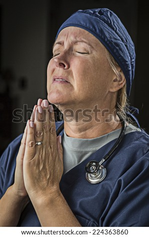 Pleading with Hands in Prayer Female Doctor or Nurse. - stock photo